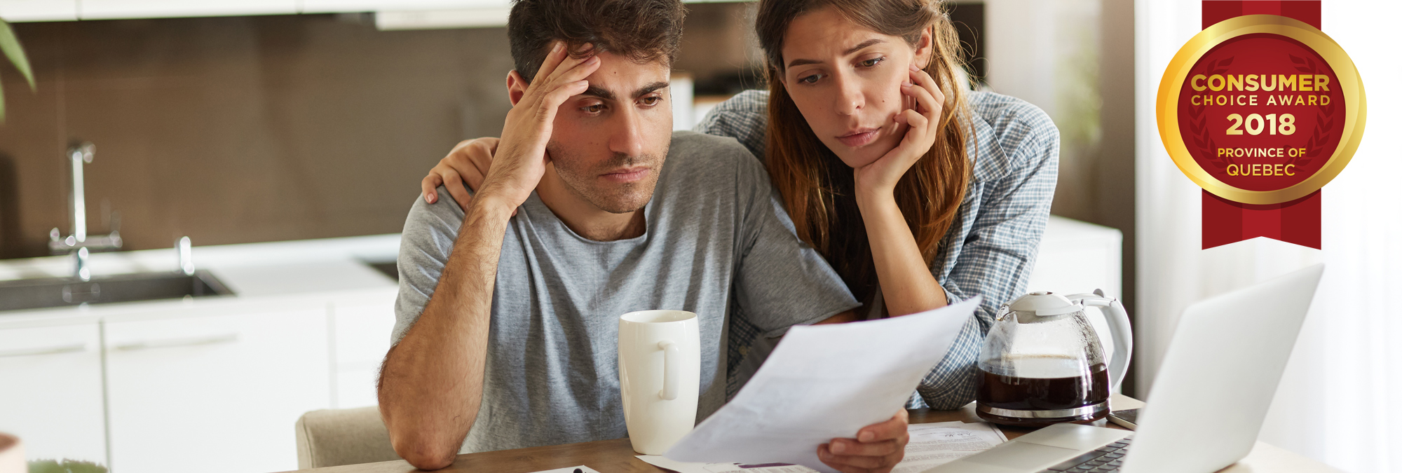 Worried couple looking at budget